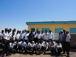 Handover of newly constructed school latrine with students