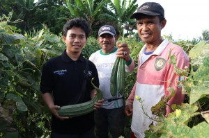 Happy farmers and rolo with crops