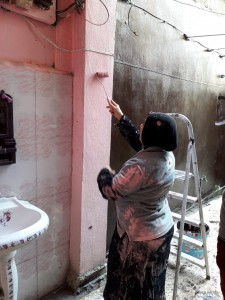 Woman painting washroom